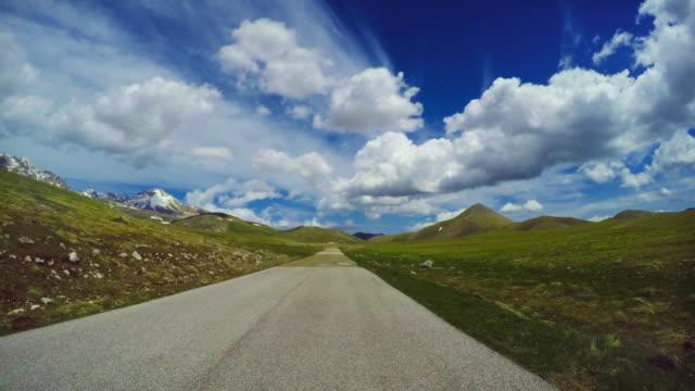 pov car driving on a mountain area - passo montano video stock e b–roll