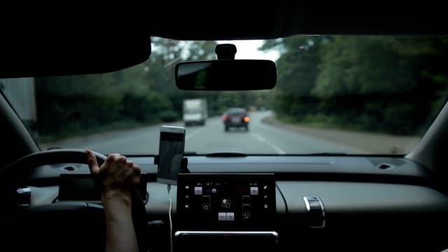 car driving on busy road in summer day - położenie filmów i materiałów b-roll