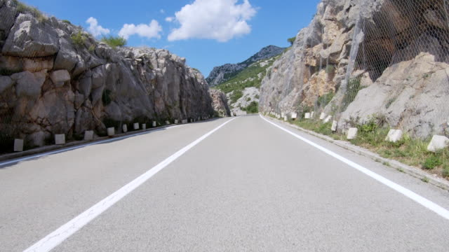 car driving on coastal road point of view - strada tortuosa video stock e b–roll