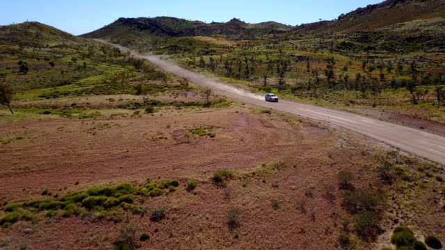 4WD car driving on dirt road in Australia's outback video