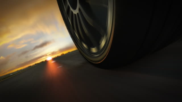 Car driving on highway in suset. Loopable CG.  tires stock videos & royalty-free footage