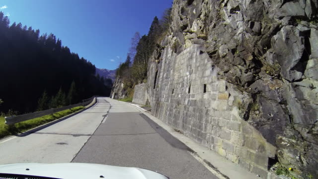 Car driving on mountain road video