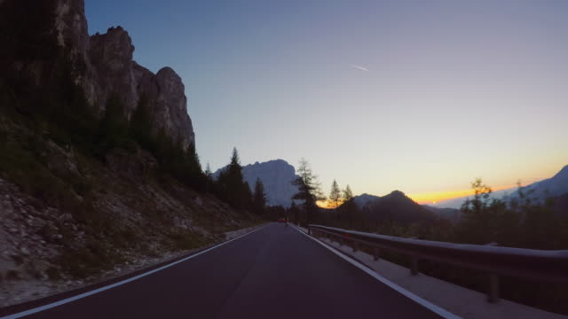 pov car driving on the dolomites: mountain pass - dusk stock videos & royalty-free footage