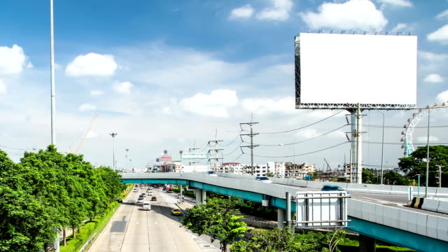 car driving on the road and advertising billboard video