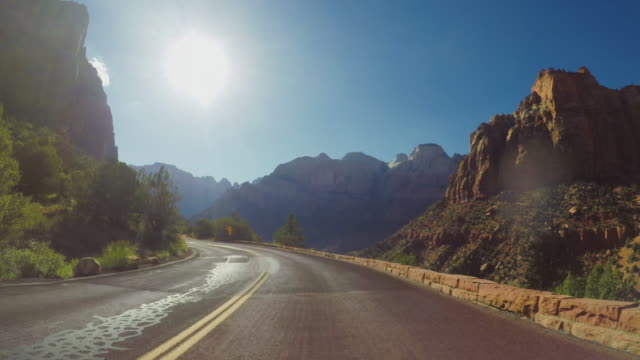 POV car driving on the Zion mountain pass in USA