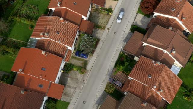 AERIAL: Car driving slowly on suburban street video