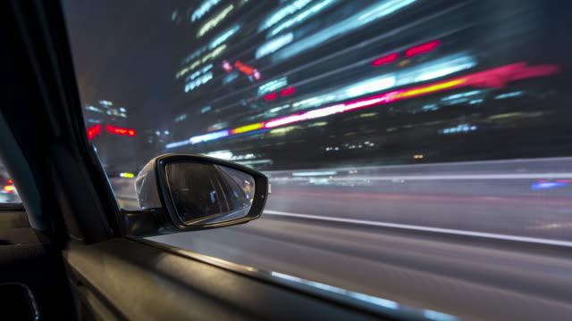 t/l ws pov car driving through city / beijing, china - sportello d'auto video stock e b–roll