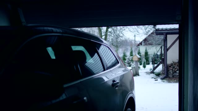 car entering the garage. winter landscape - entrare video stock e b–roll