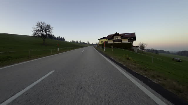 Car POV: foggy Austrian country road in autumn