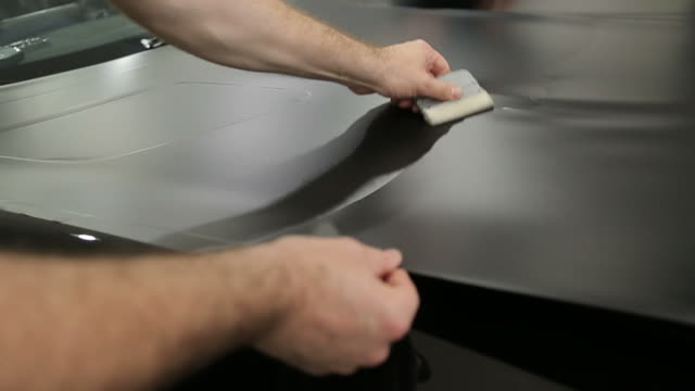 car foil wrapping - avvolto video stock e b–roll