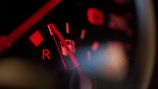 Car fuel gauge showing low fuel level video