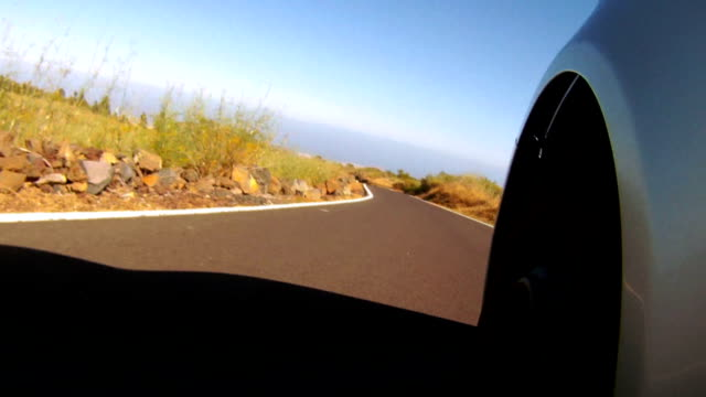 Car going by a beautiful high mountain road video