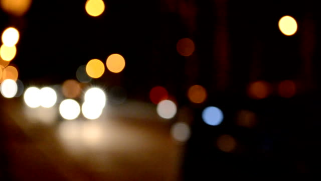 car in the city, out of focus. - rack focus video stock e b–roll