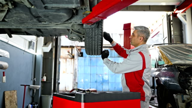 Car Installing Tire - Vehicle Part in the Auto Repair Shop - 4K Resolution Summer, Winter, Tire - Vehicle Part, Wheel, Installing vehicle part stock videos & royalty-free footage