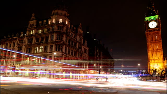 car light trails slow motion night timelapse showing westminster and big ben in london, england, uk - london architecture stock videos & royalty-free footage