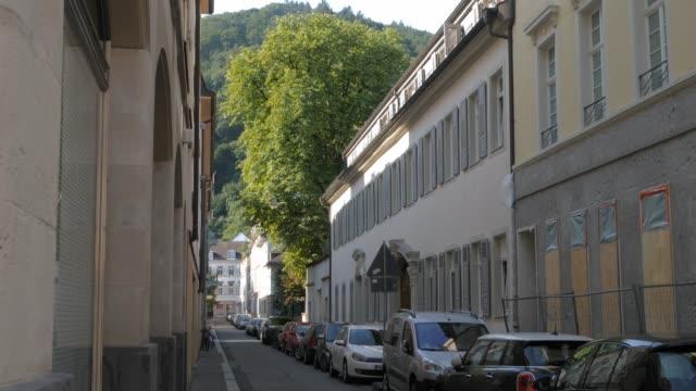 car lined street in heidelberg, germany 4k - barocco video stock e b–roll