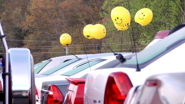 Car Lot Pan shot of cars for sale. car dealership stock videos & royalty-free footage