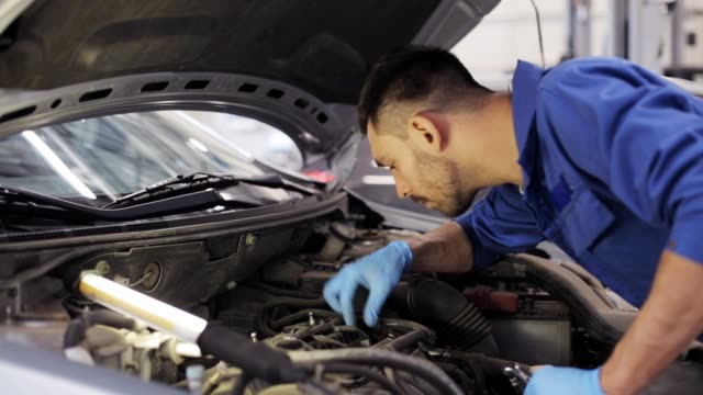 car mechanic with wrench working at auto repair shop video