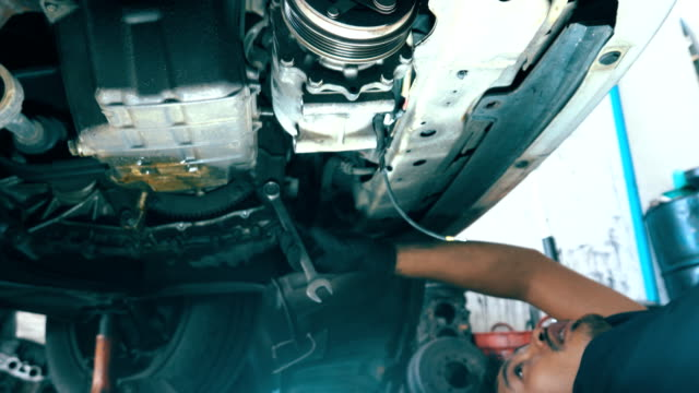 car mechanic working at auto repair shop - mechanic video stock e b–roll