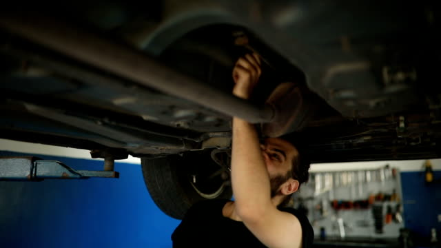 Car mechanic working at workshop video