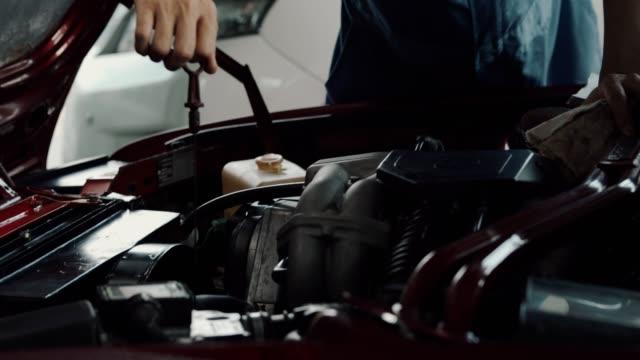 car mechanic working in garage - klucz ręczne narzędzie filmów i materiałów b-roll