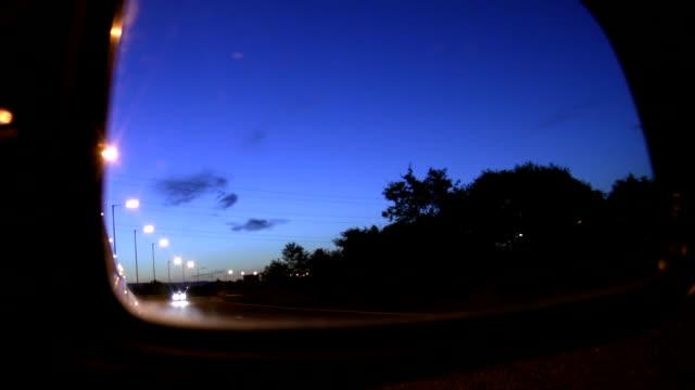 Car mirror view of night street video