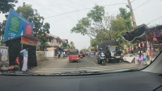 MS Car moving along busy street,Sri Lanka video