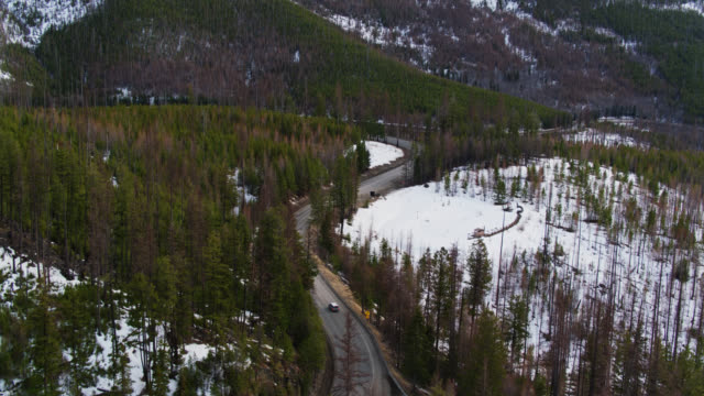 Car on Winding Road in Sherman Pass, Washington in Early Spring - Drone Shot