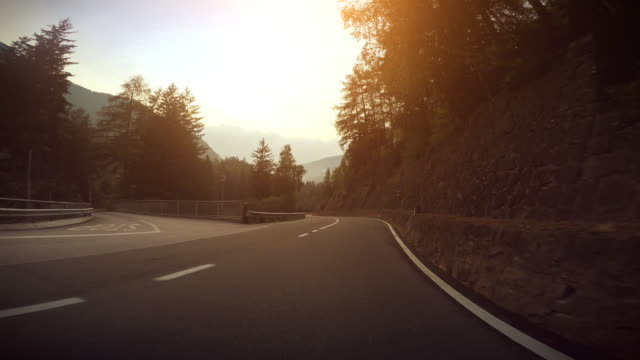 Car Onboard Camera: curvy sunset Car Onboard Camera on Road, driving curvy section during a warm sunset. curve stock videos & royalty-free footage