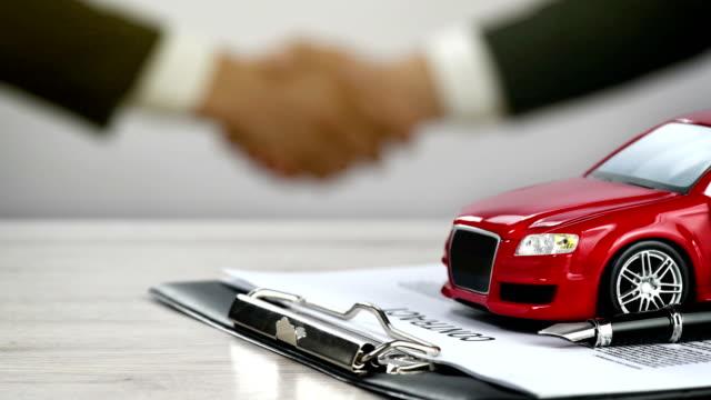 Car Ownership - Car Rental - Car Contract - Handshake - 4K Resolution