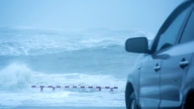 Car Parked On Sea Coast Watching Stormy Ocean Slowmo video