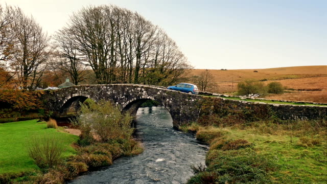 Car Passes Over Old Stone Bridge video