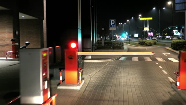 Car Passing Barrier at Night Dash Cam POV