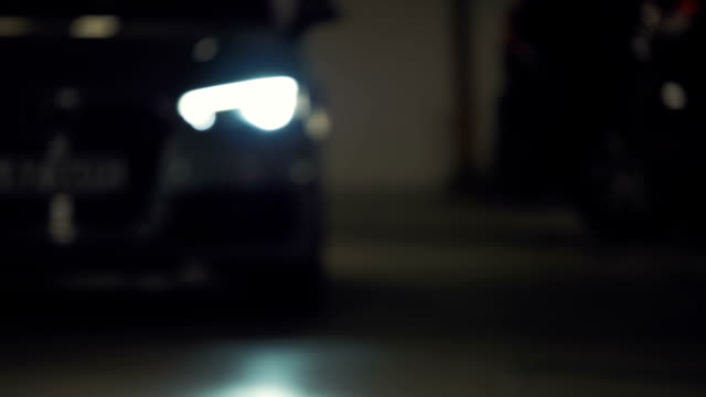Car Pulls Up Flashing its Headlights, Rack Focus A car pulls up towards the camera flashing its headlights brightly. Extreme close up. Rack focus. sports car stock videos & royalty-free footage