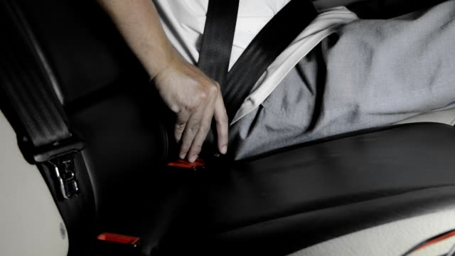 Car rear passenger seat unfasten seat belt