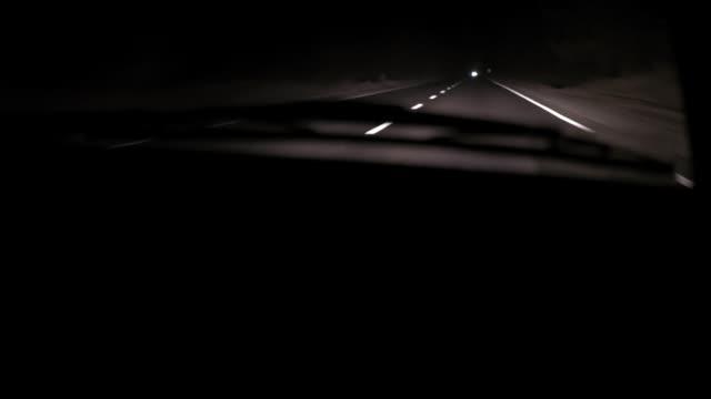 bil rider på vägen natt. vy innifrån - wheel black background bildbanksvideor och videomaterial från bakom kulisserna