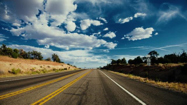 pov bil vägkörning nära canyonlands, moab - bilperspektiv bildbanksvideor och videomaterial från bakom kulisserna