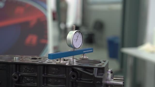 Car Service Measuring Device Car service measuring device internal parts engine machine vehicle motor repair station camera movement crank mechanism stock videos & royalty-free footage