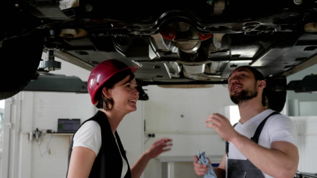 Car service, Professional maintenance people concept, car's service worker Advised client, helps feminine customer on station video