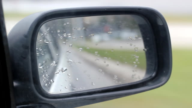 Car Side Mirror Chasing Car Specifications: Full HD 1920_1080 .PhotoJPEG codec (.MOV) format. rear view mirror stock videos & royalty-free footage