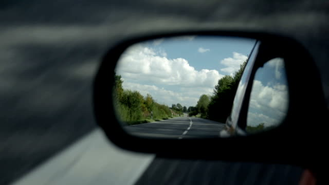 Car side mirror Road appearing in the side mirror of a  car rear view mirror stock videos & royalty-free footage