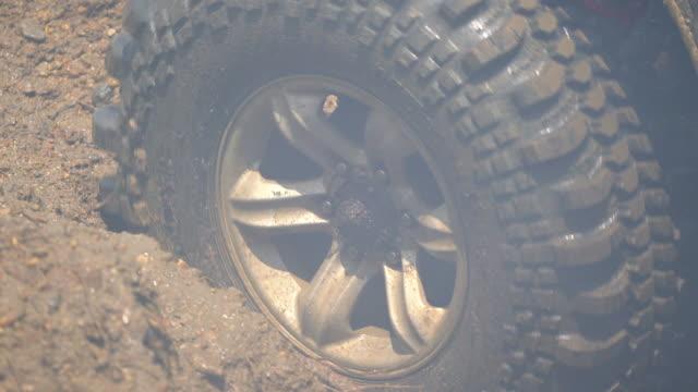 4wd car stuck in muddy off-road - truck tire video stock e b–roll