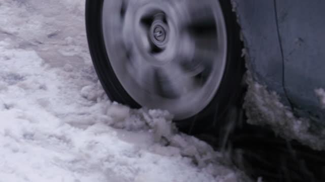 Car stuck, wheel slip spinning skating, snowy frozen streets video