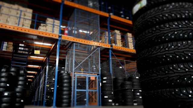 Car Tires At Warehouse In Tire Store. A Huge Warehouse of a Car Tires With Elevator video