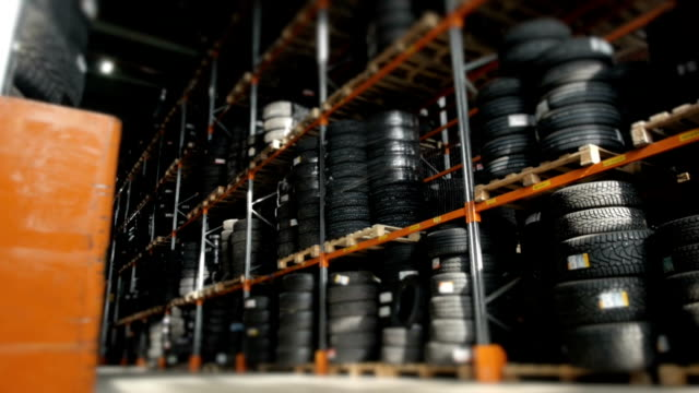 Car Tires At Warehouse In Tire Store. A Huge Warehouse of a Car Tires Stored On Shelves Car Tires At Warehouse In Tire Store. A Huge Warehouse of a Car Tires Stored On Shelves, HD tires stock videos & royalty-free footage