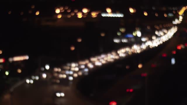 Car traffic in night city, defocus video