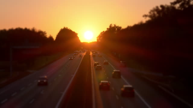 car traffic on highway at sunset - autobahn video stock e b–roll
