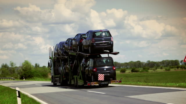 car transporter truck on the highway road car transporter truck on the highway road car transporter stock videos & royalty-free footage
