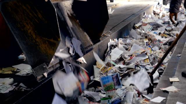 Car unload garbage into sorting conveyor. Waste sorting. video