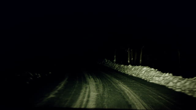 Car View of a Dark Bumpy Road at Night and During the Winter video